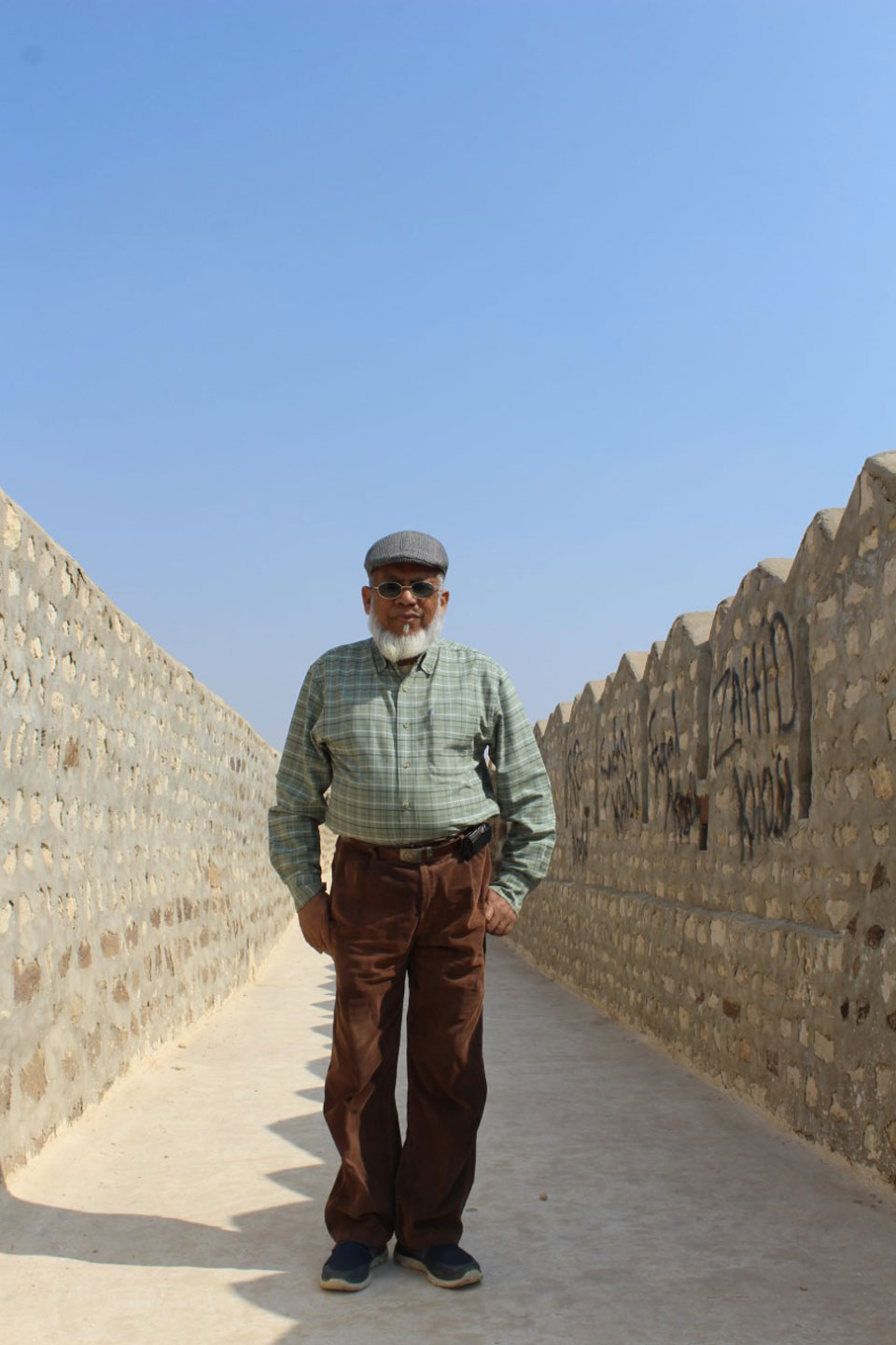 Engr. Iqbal Ahmed Khann is standing on the walk way on top of the Miri Kot. Onne can see all round and also one can view of the Sher Garh Gate of entry gate which is very difficult to reach.