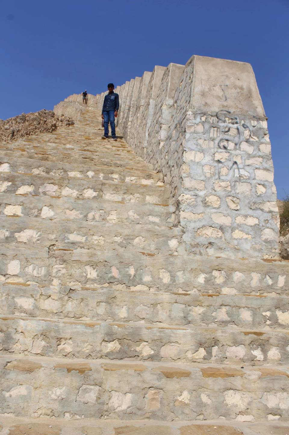 Habib Ur Rehman is climbing the stairs to reach the top of the Great Wall of Sindh, Rani Kot Fort