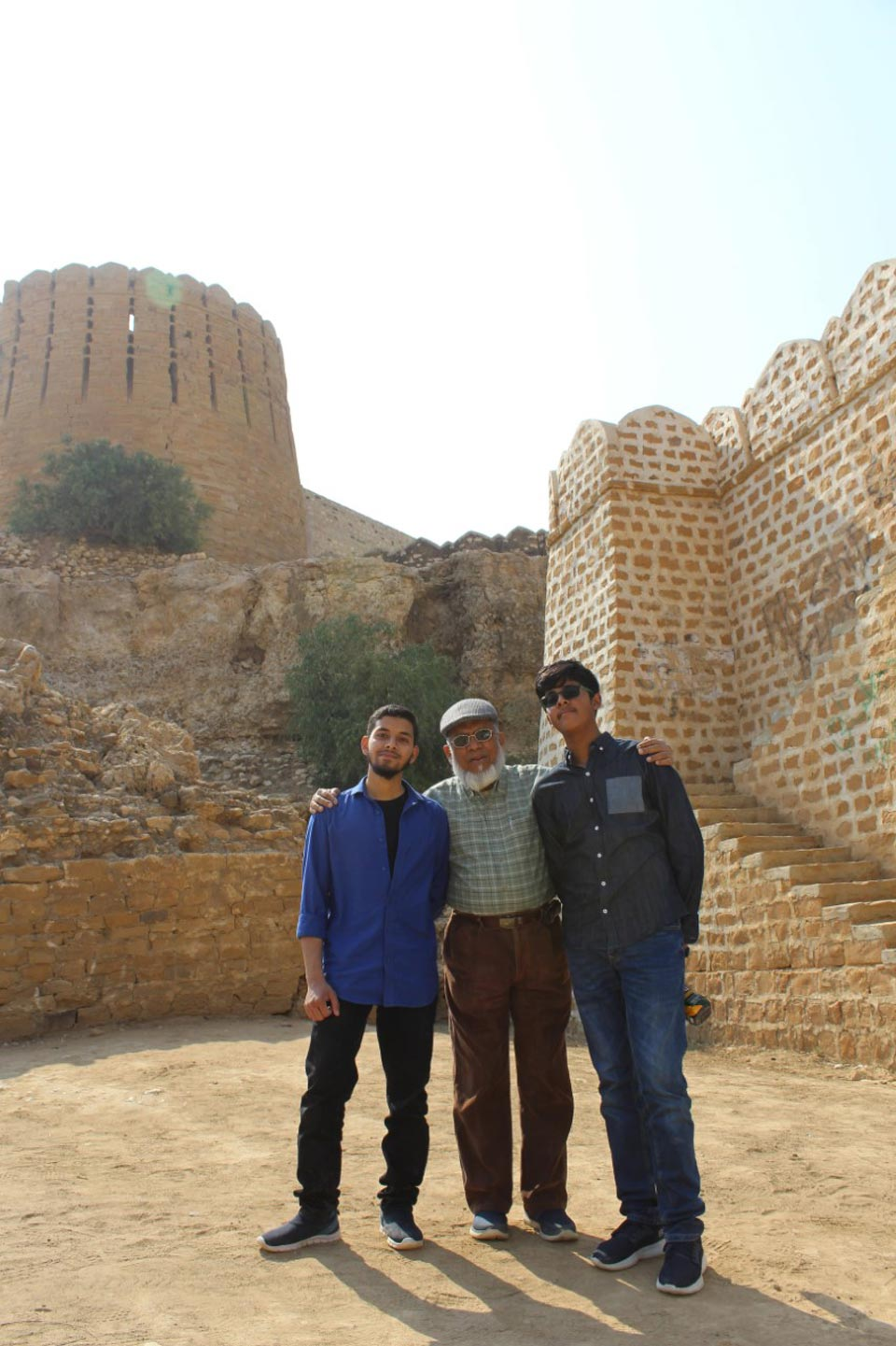 "After coming down from the Great Wall of Sindh the two brothers are with their ""Nana"", Grand Father Engr. Iqbal Ahmed Khan"