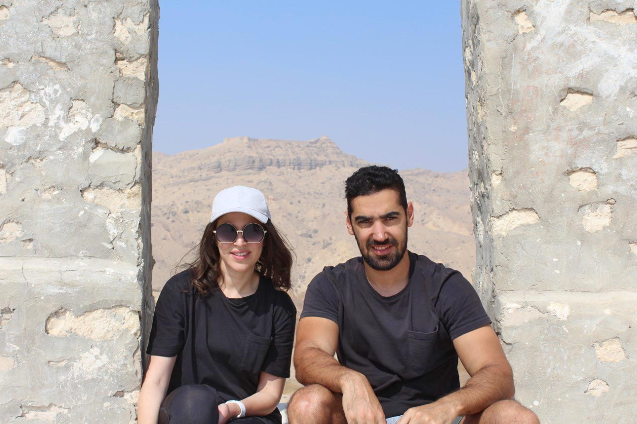 Ms. Emaan and Mr. Firaz are sitting the space in between the two walls on top of Miri Kot roof