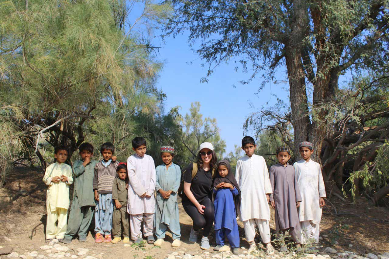 While an hour trekking from Rani Kot Restaurant to Pariyon Ja Tar, Ms. Emaan with the local residents kids