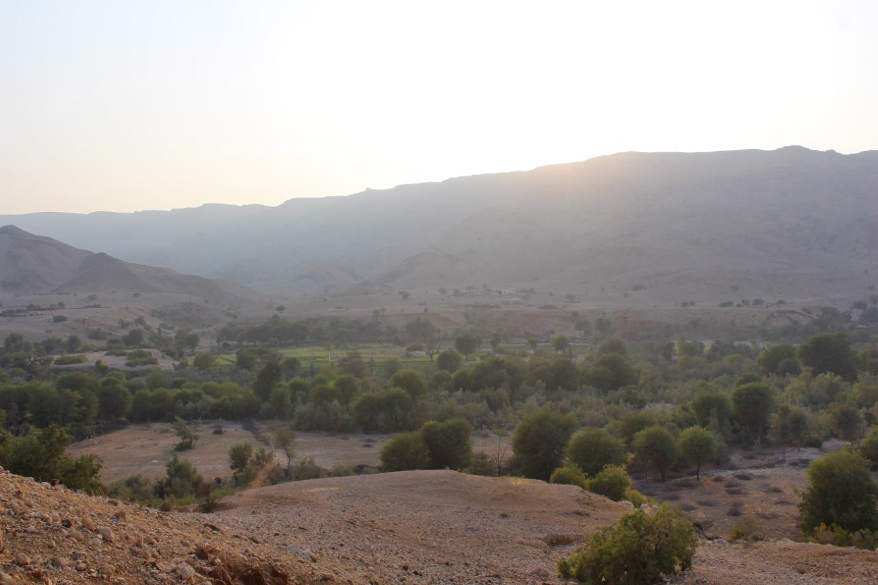 "The nice view of the area showing the mountains and the greenery around the fresh water stream "" Pariyon Jo Tar"""