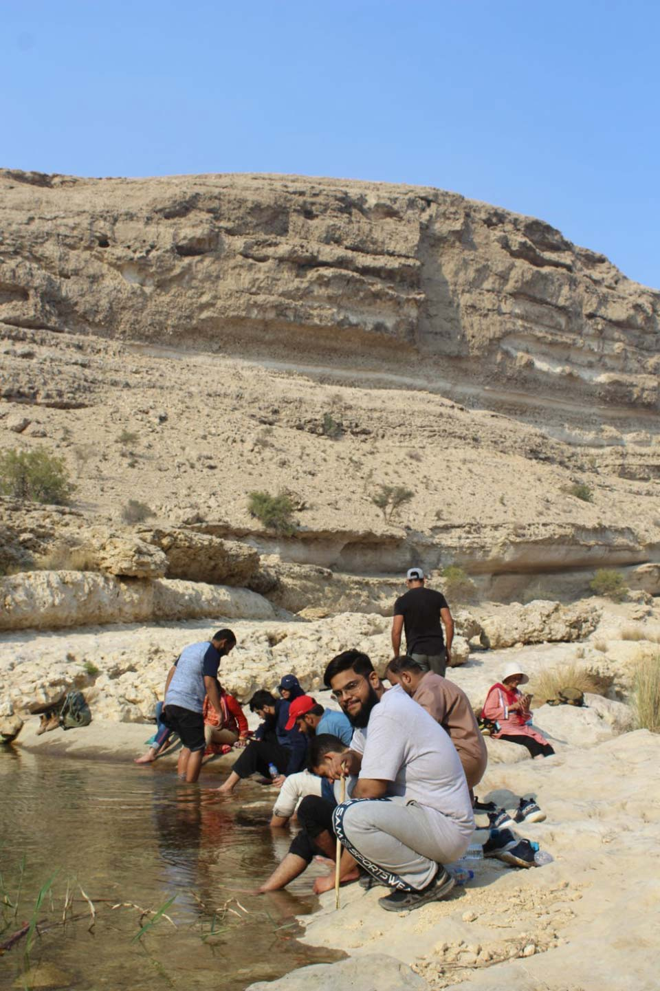 All the members are relaxing with their feet in the fresh water stream after trekking for an hour. They are getting ready to do an hour of trekking back to the Rani Kot Restaurant.