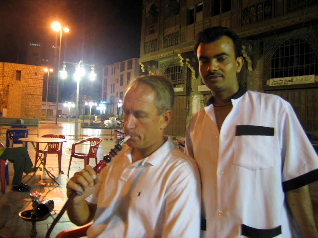 Smoking a hookah pipe in the plaza. © Mark Lowey
