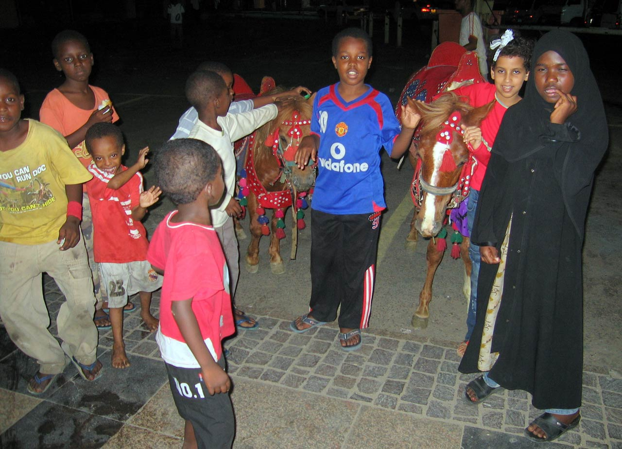 Local children offer donkey rides. © Mark Lowey