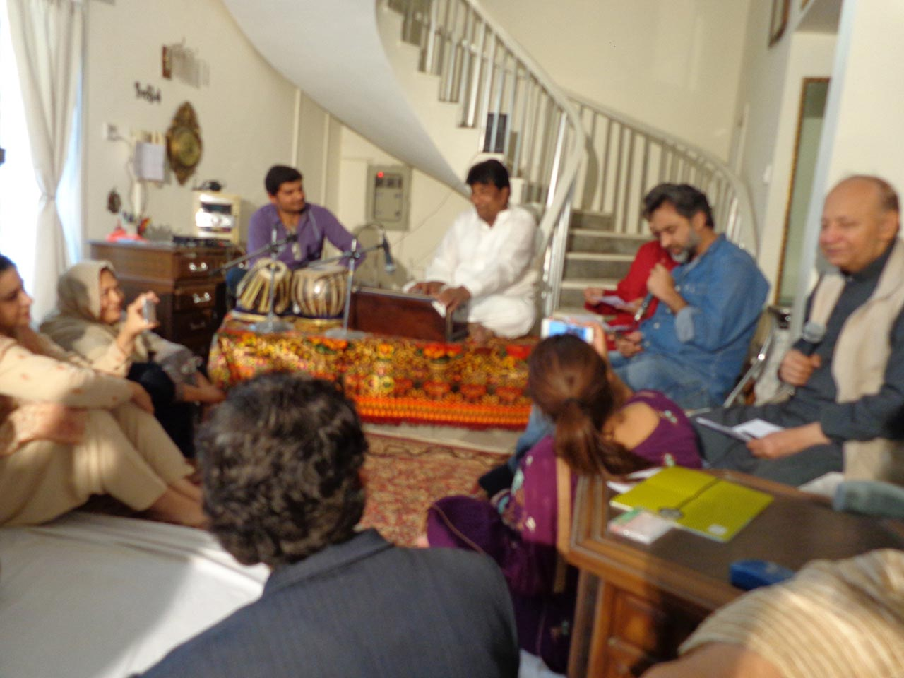 Abrar Asif is singing his ghazal at the musical party