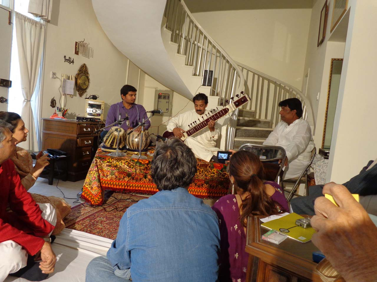 Ustad Saleem Khan is playing melodious tunes on sitar at the musical party