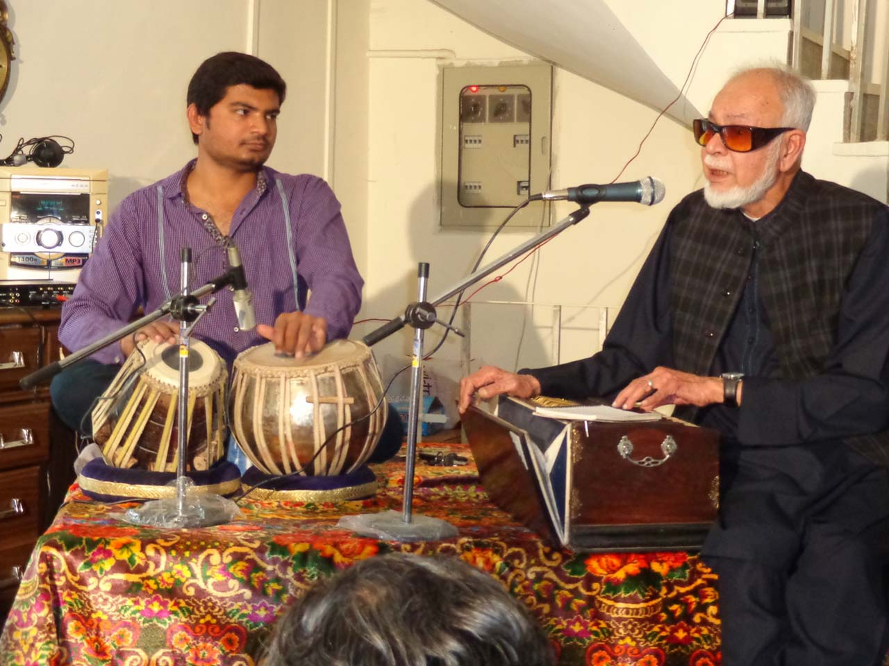 Syed Mehmood Ali is singing a ghazal on the request of Dr. Siddiqui