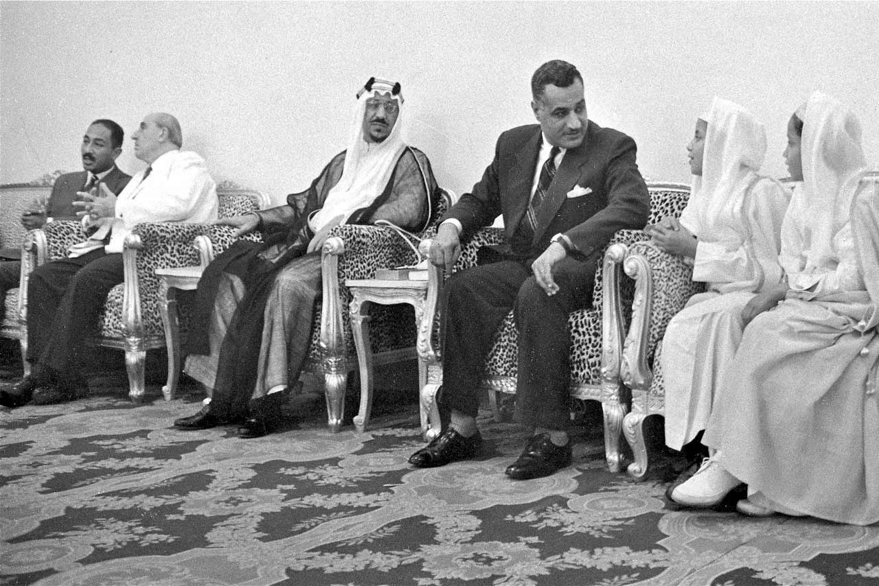 King Saud listens as Egyptian President Gamel Abdel Nasser chats with two princes. On the left, Syrian President Kuwatli  speaks to vice President Anwar Sadat.