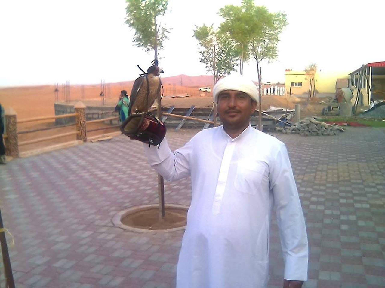 Golden Falcon with Abdullah near Omani border, United Arab Emirates. Photo by Mihir Manek.