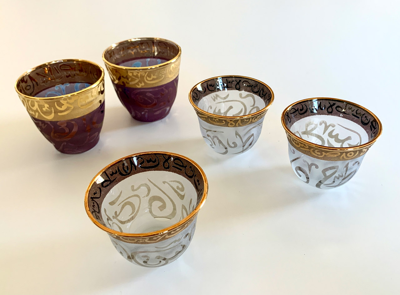 Hand-painted cups and pitchers with Arabic script motif. © Mark Lowey