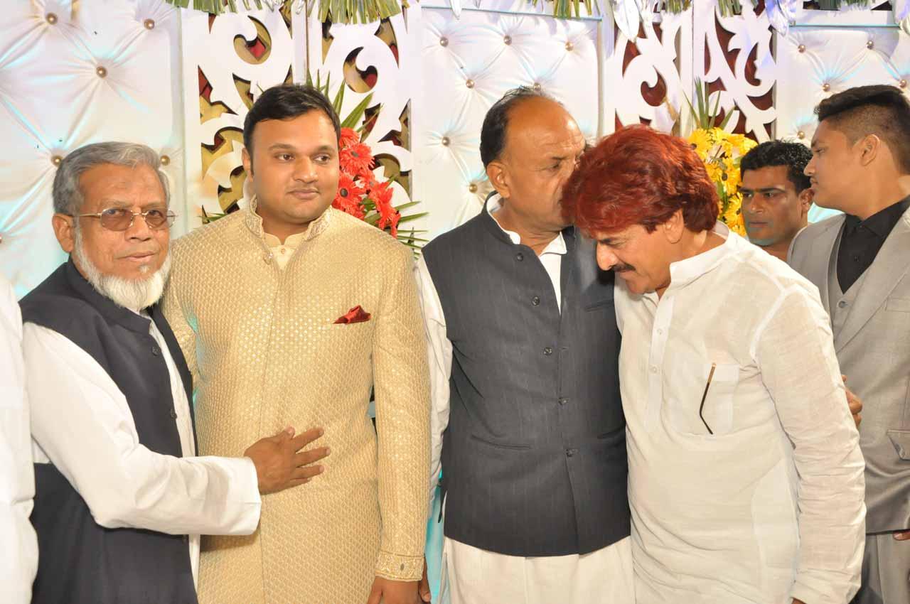 Engr. Iqbal A. Khan congratulating Imran after the Nikah