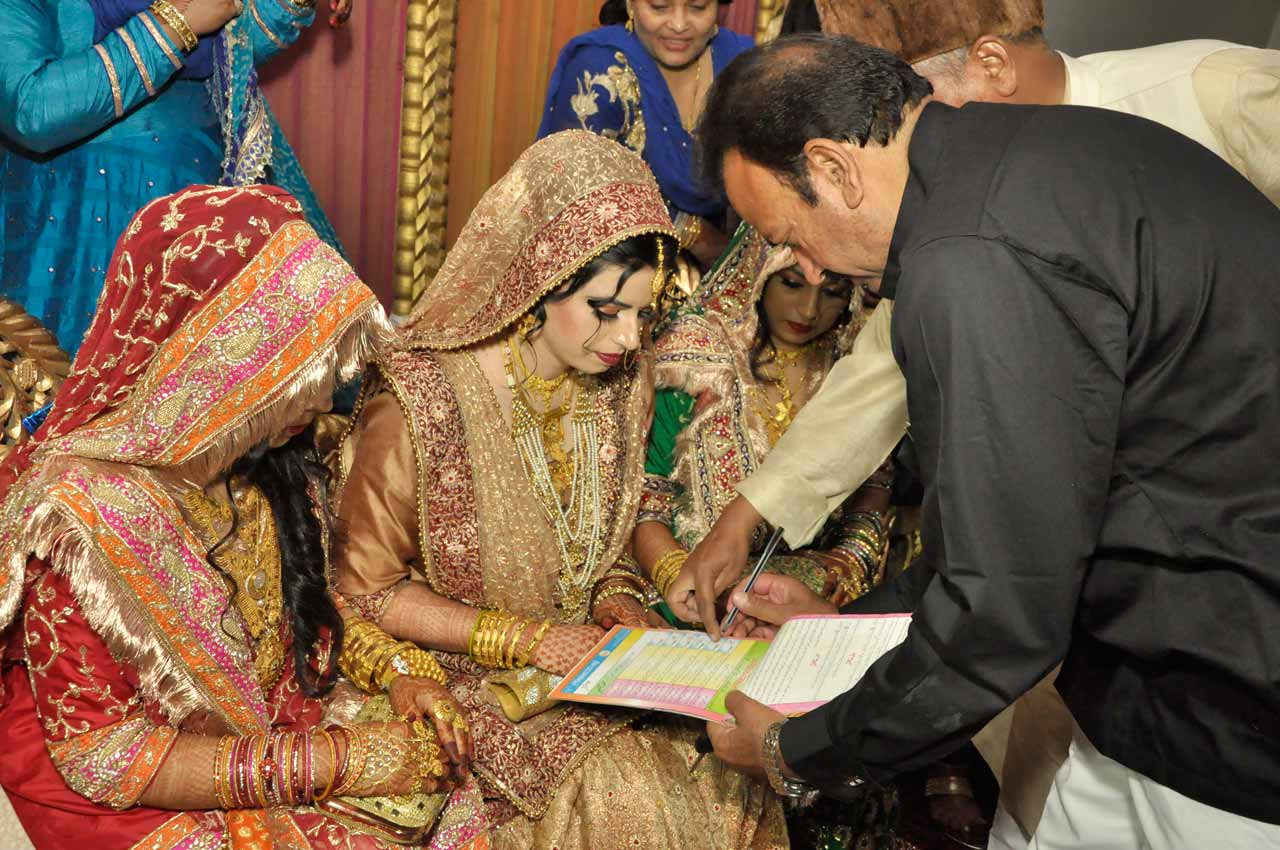 Huma Khan is signing the Nikah documents