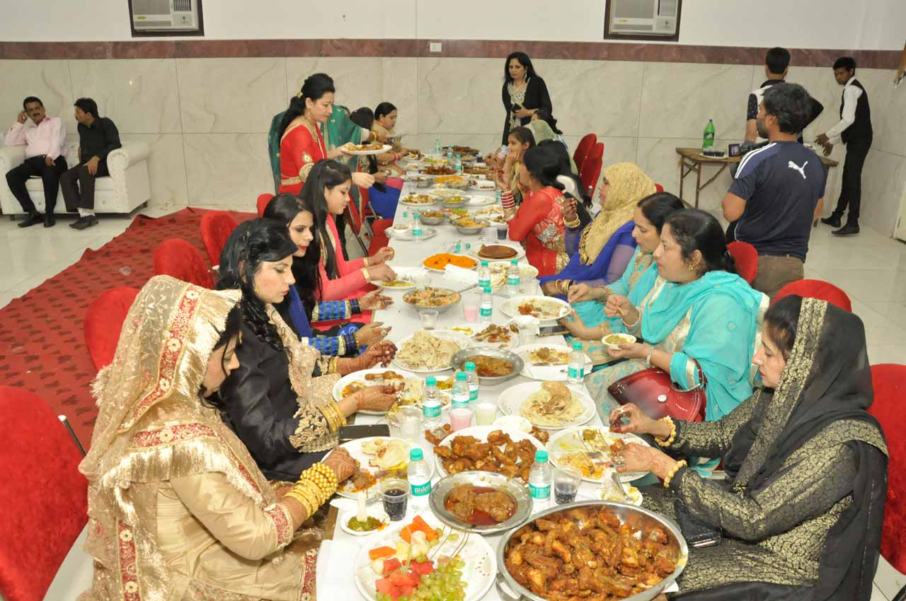 The ladies from the bride side are being served the dinner