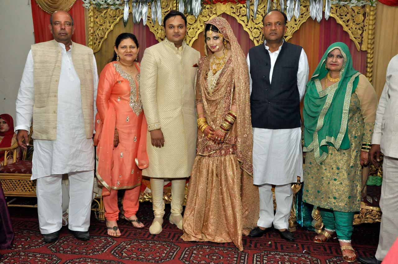 The newly wed couple with their parents