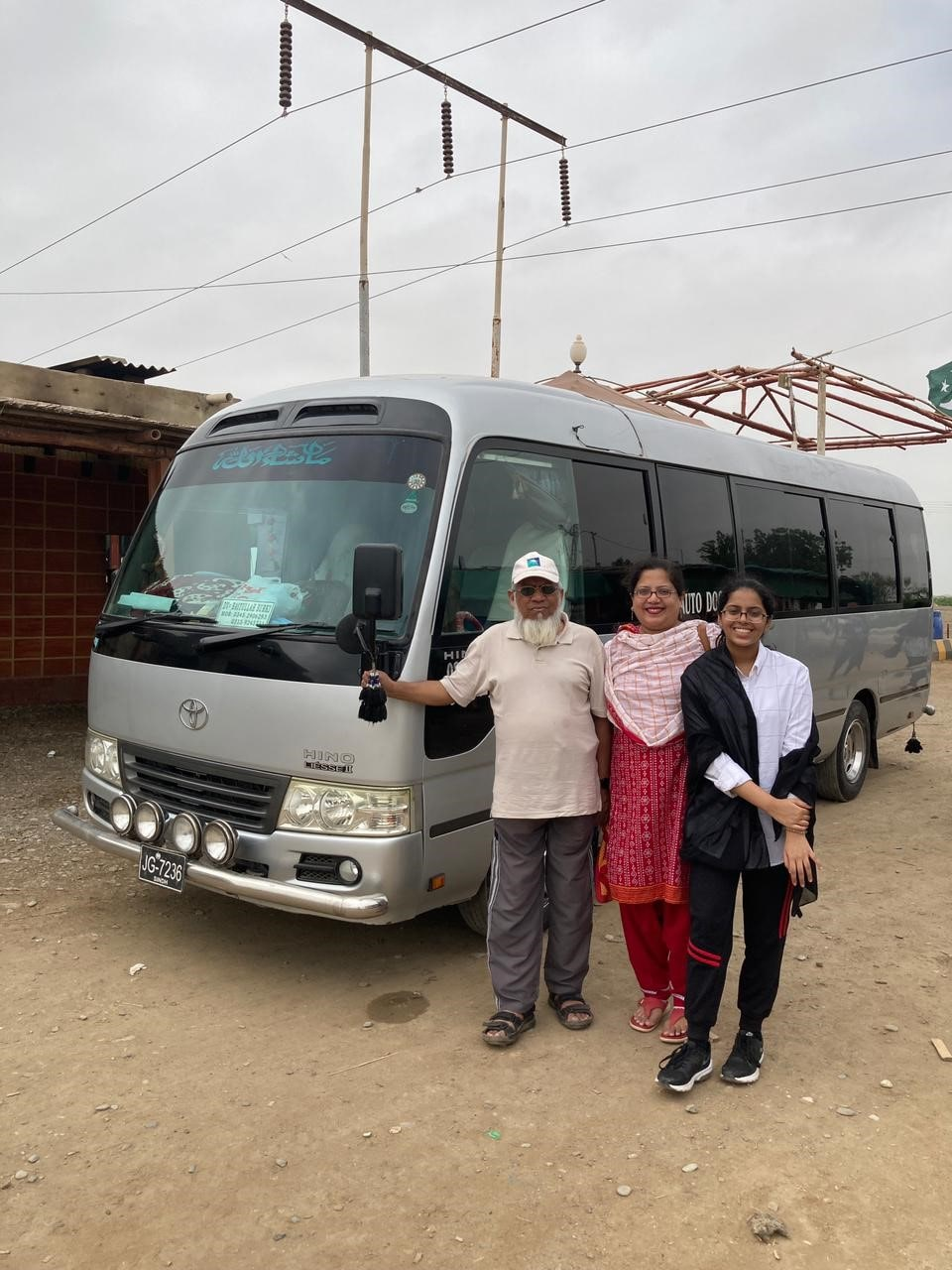 Engr. Iqbal Ahmed Khan in front of the Toyota Coaster with his daughter Dr. Kiran A. Rehman and granddaughter Mariam A. Rehman at Kund Malir.