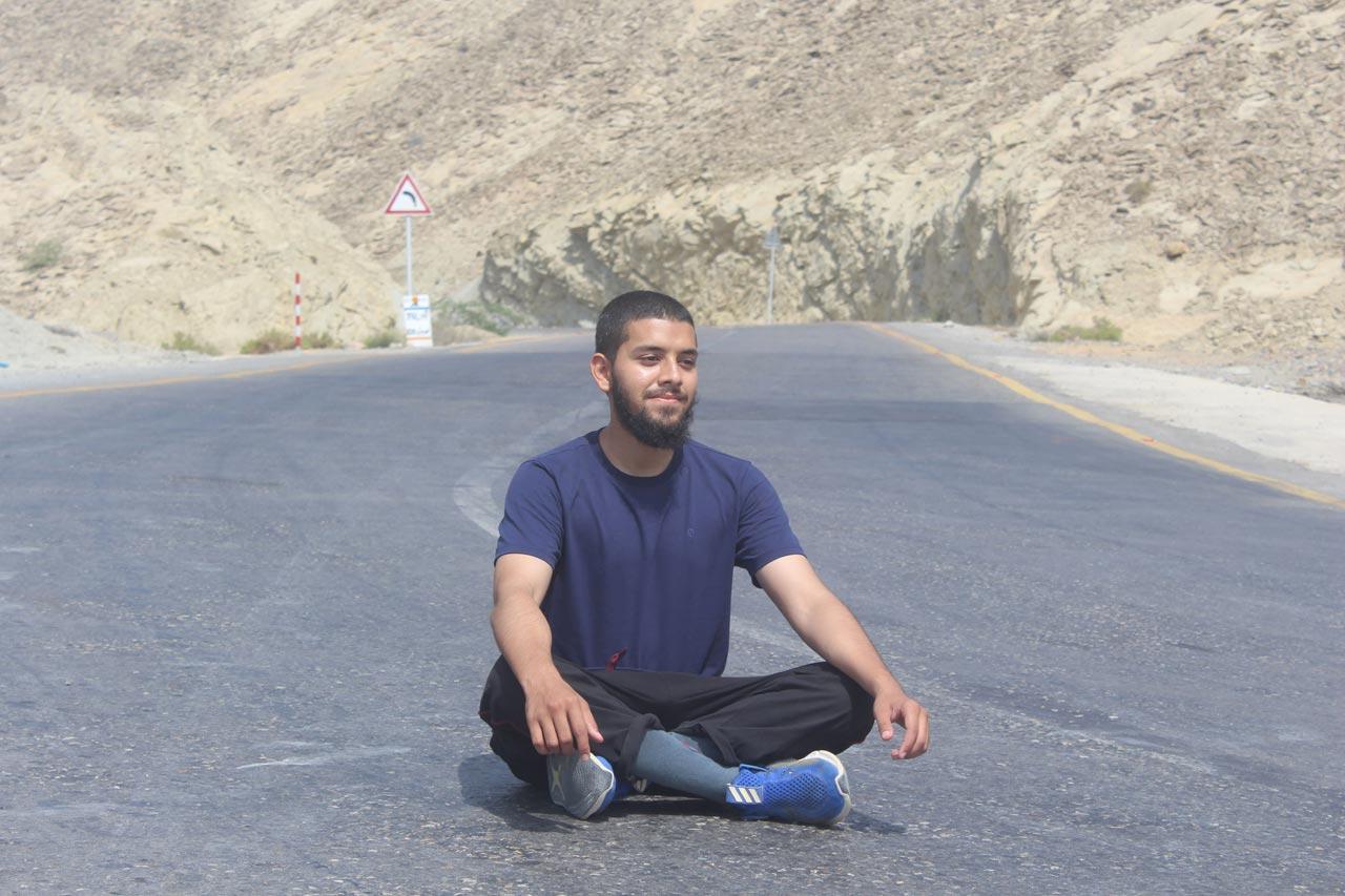 Engr. Obaid Ur Rehman is practicing Yoga on the Makran Coastal Highway at Kund Malir.