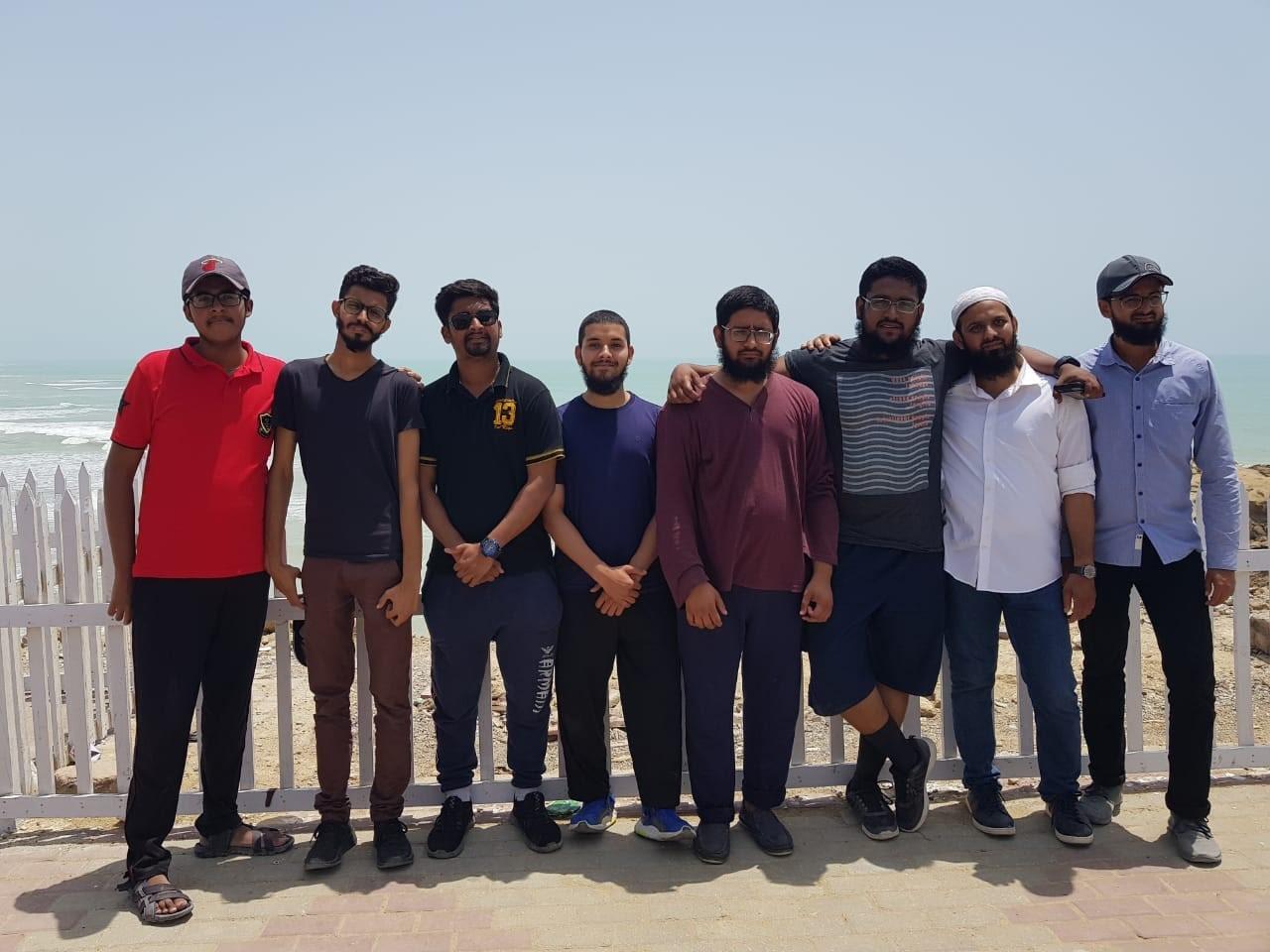 Habib, Ahmed, Usama, Obaid, Zubair, Anus, Zubair Kamali and Hamid enjoying the fresh breeze and the noise of waves at the view point of Kund Malir Beach.
