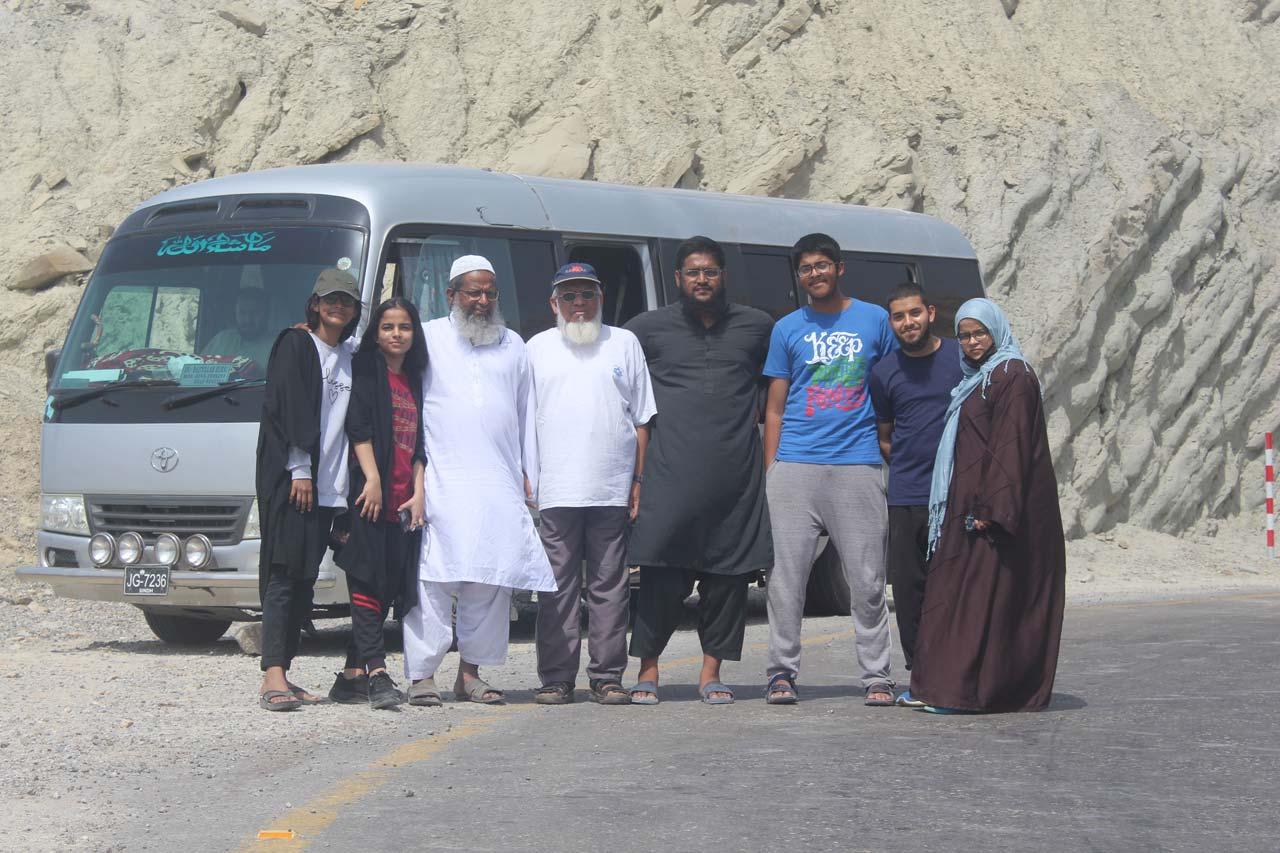 Hadia, Khaula, Abdul Bari, Engr. Iqbal Khan, Anus Abdul Bari, Habib, Obaid and Umaima in front of the Coaster at Kund Malir.
