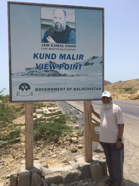 Engr. Iqbal Ahmed Khan at the sign board of Kund Malir View Point on our way to Ormara Beach.