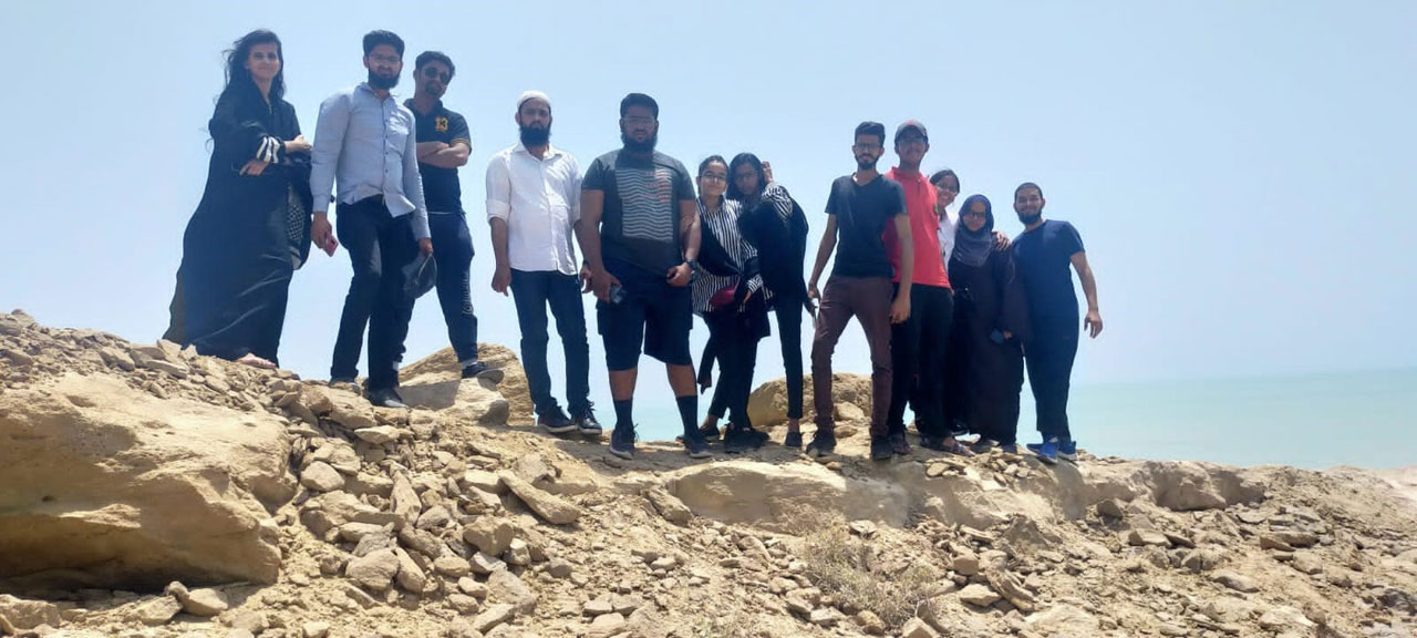 Our group members standing on top of the view point at Kund Malir Beach enjoying the view.