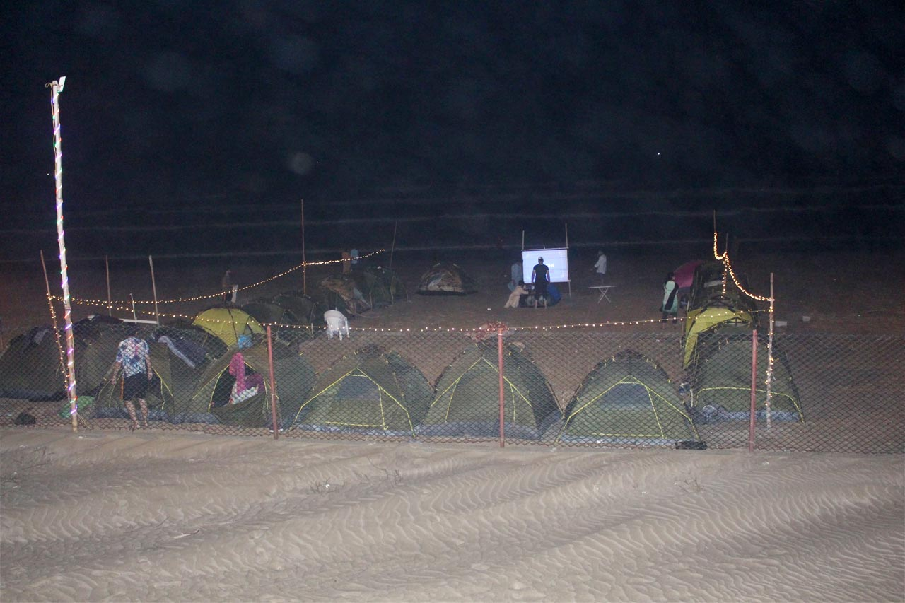 The movie session is ongoing at Ormara Beach with tents camp all around, all are enjoying.