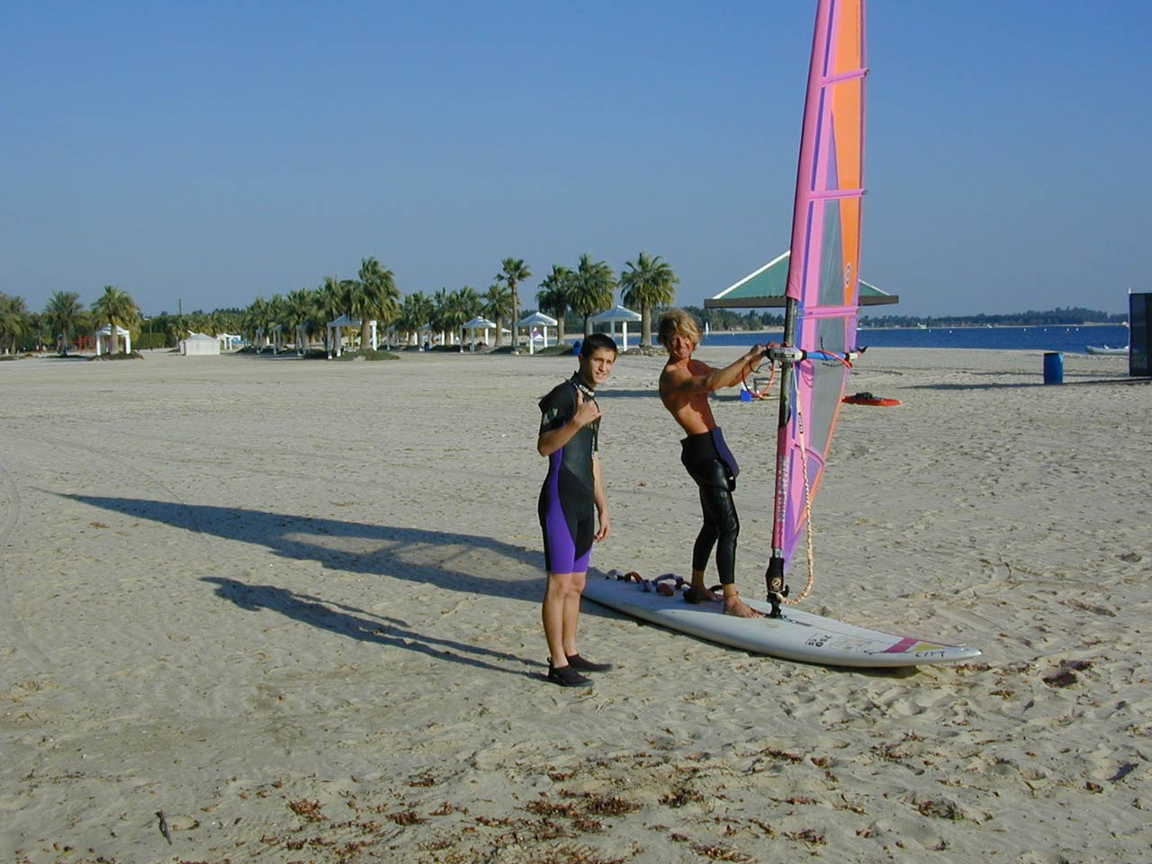 Andrew Kochinski taking windsurfing lessons from John Nielson, a teacher at Dh School