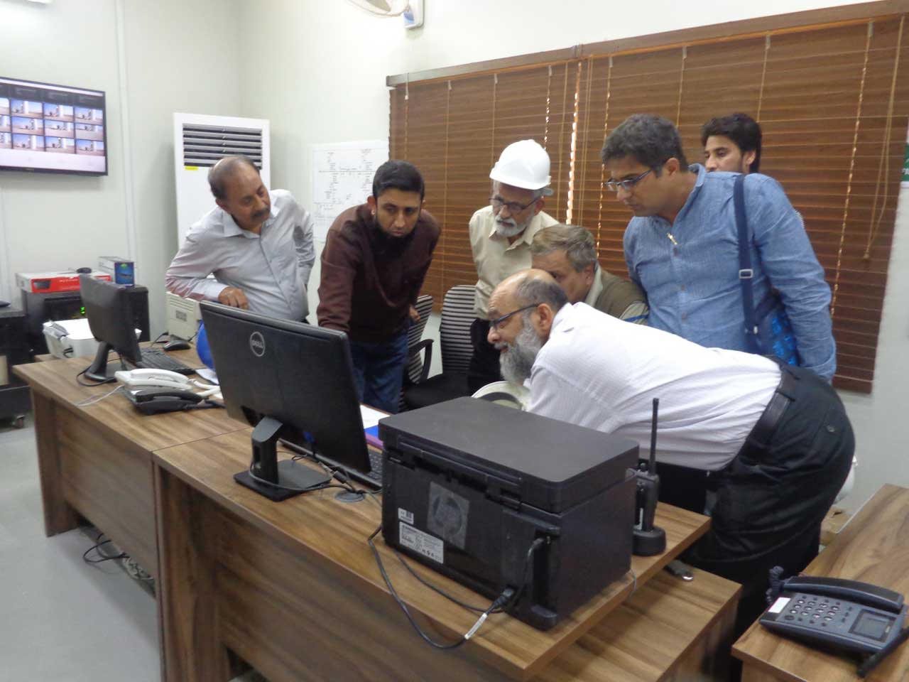 Engr. Ejazul Haque, Engr. Jamil Ahmed, Engr. Maqsood Ahmed, Engr. M. Rizwan and M Taufiq Bilwani are discussing in the control room