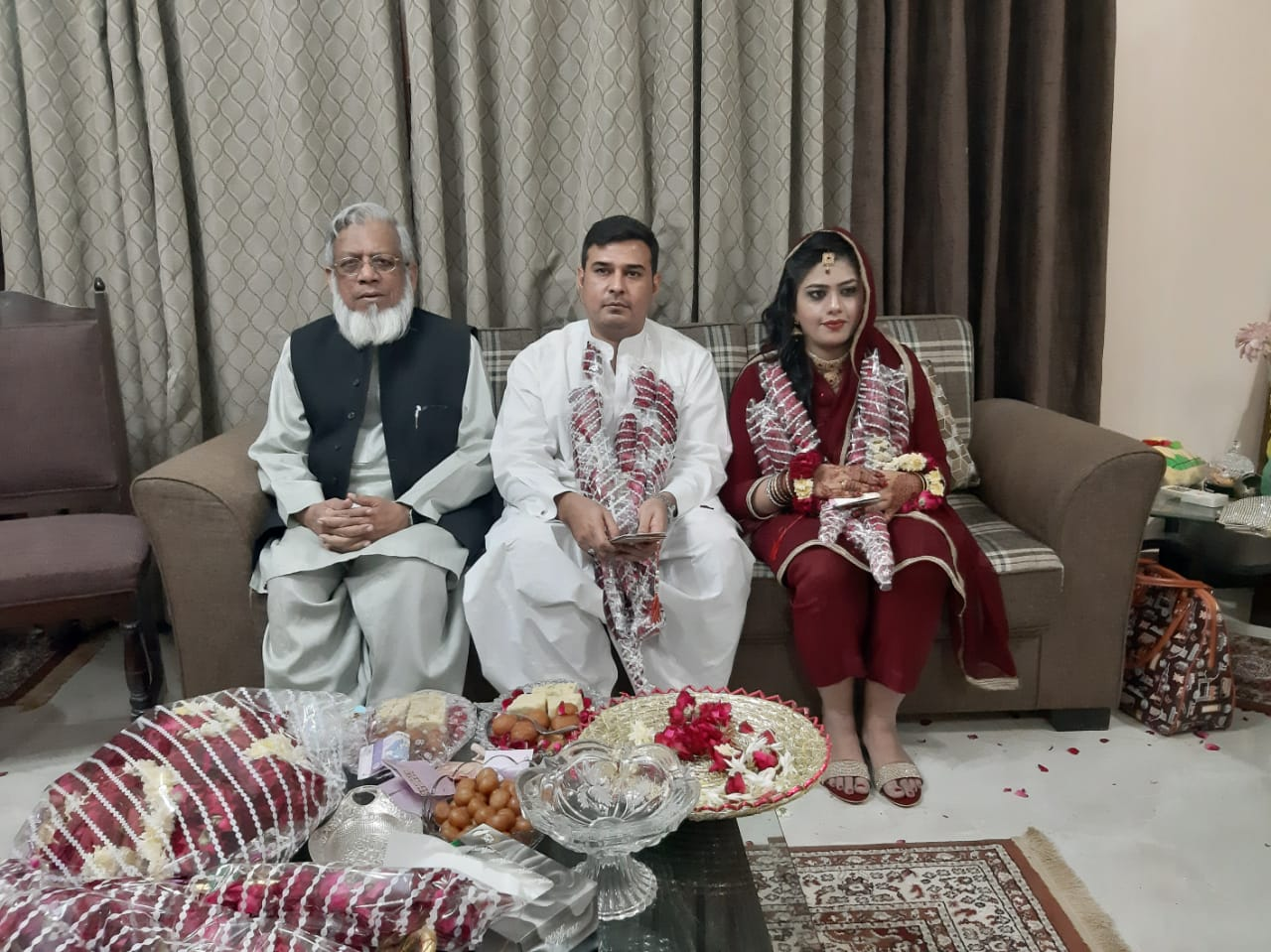 Engr. Iqbal Ahmed Khan with Kamran and Bushra at the Engagement Ceremony