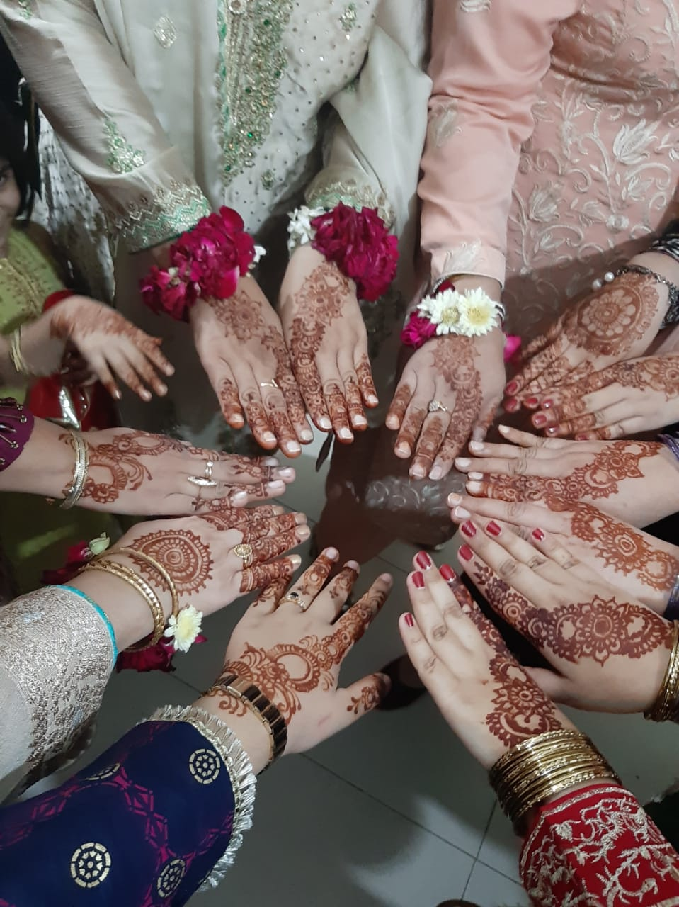 Everyone is showing their hands with nicely decorated Henna