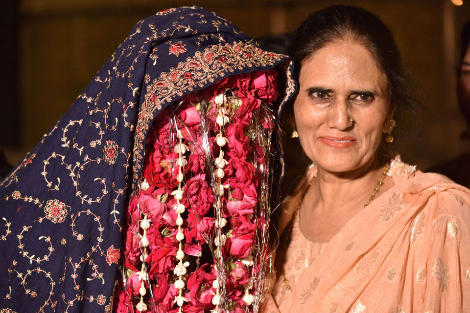 Mrs. Rudaba Irshad bidding her daughter farewell on the wedding day at the Rukhsati