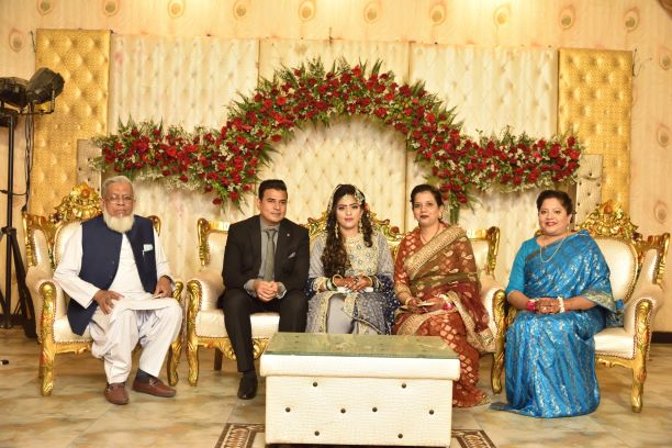 Engr. Iqbal A. Khan, Erum Imran and Dr. Kiran A. Rehman with the couple at the Valima reception