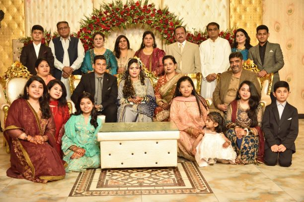 A stunning shot of the groom's family with the couple