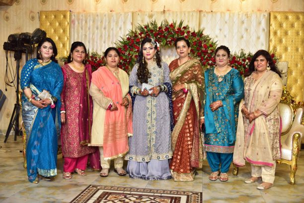 The groom's sisters with the bride Bushra at the Valima reception