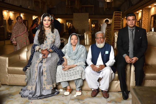Engr. Iqbal A. Khan and Mrs. Zohra Iqbal with the couple at the Valima reception