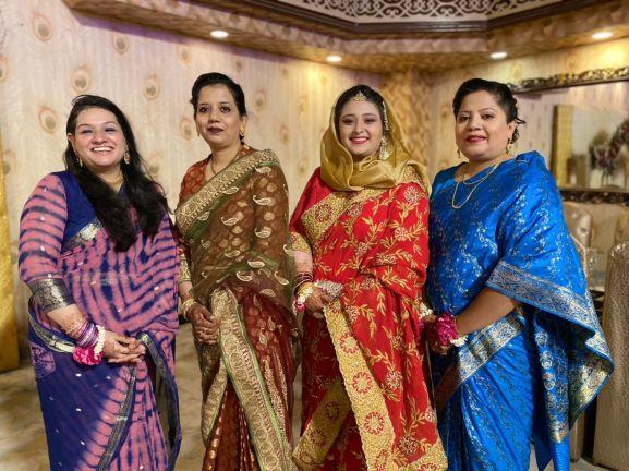 A nice group wearing beautiful sarees at the Valima reception