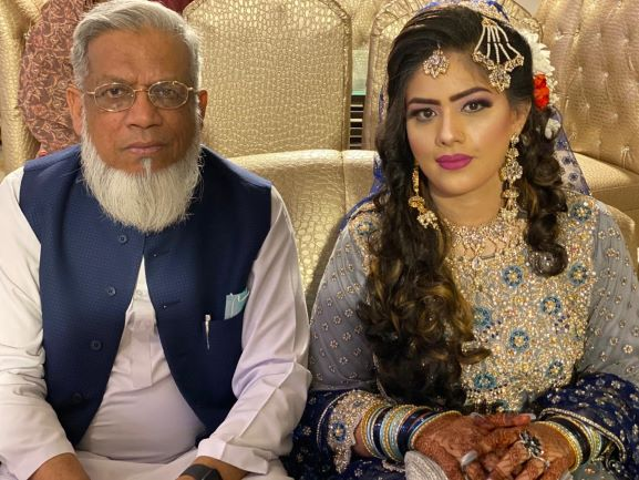 A beautiful shot of Engr. Iqbal Ahmed Khan with his niece Bushra Irshad at the Valima reception