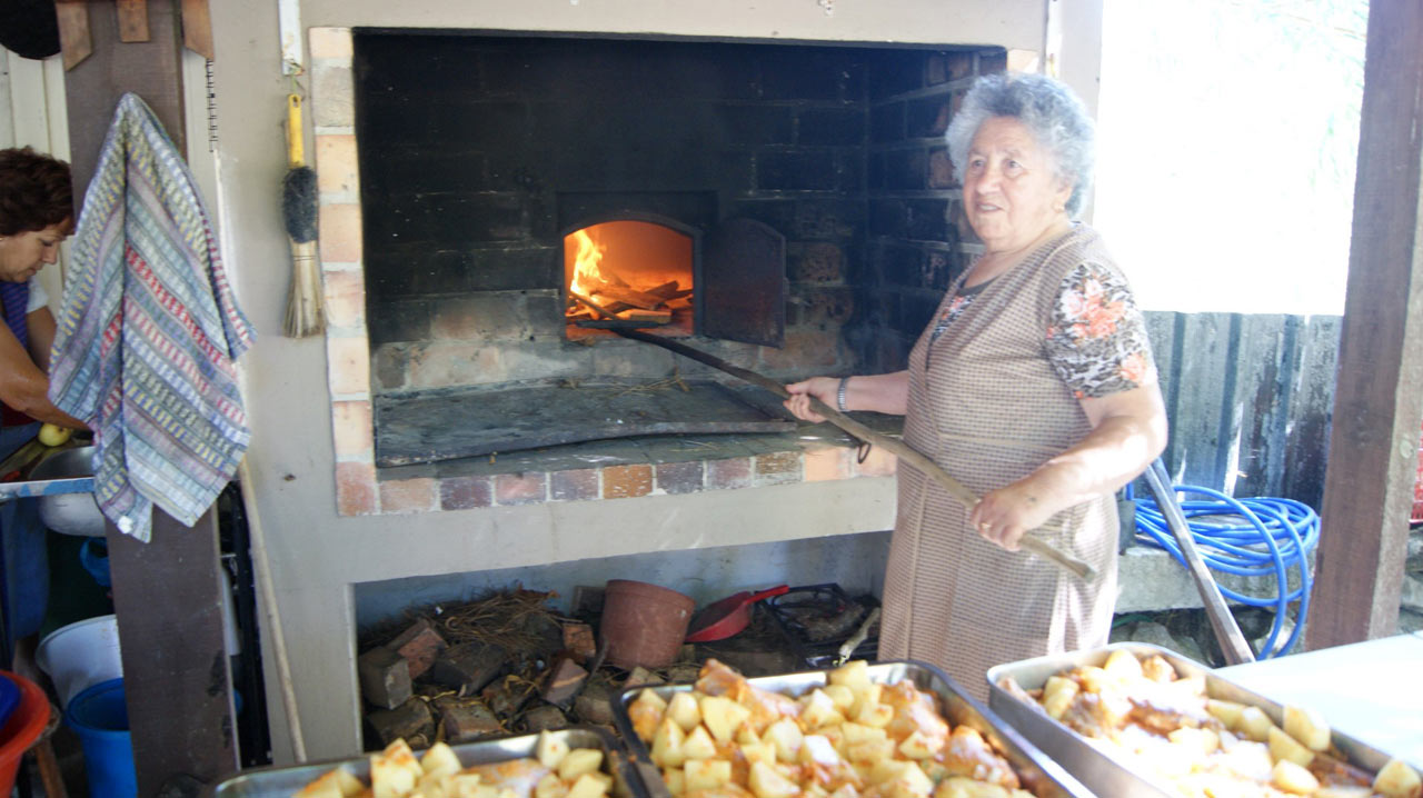 Florinda Preparing The Wood Oven