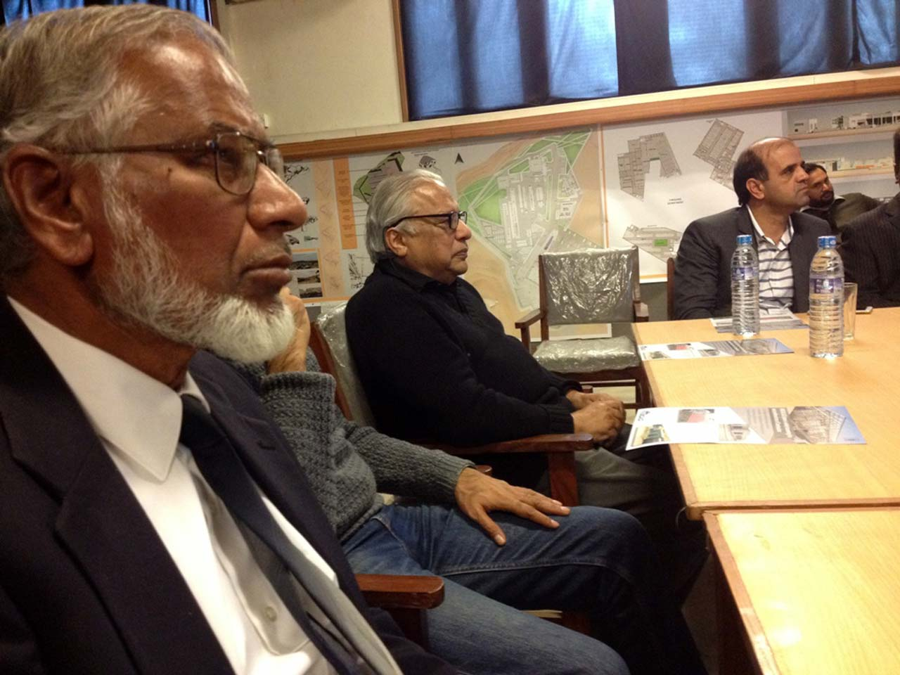 Engr. Col(R) Javed Majid and Arif Hasan watching the presentation by Engr. Badar Khan