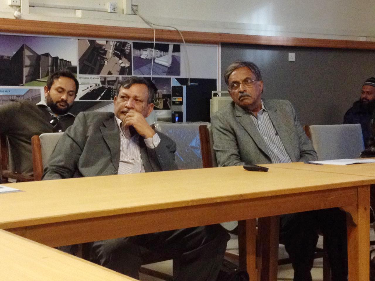 Engr. Syed Javed Nasir and Engr. Badar Khan listening to a question from the audience