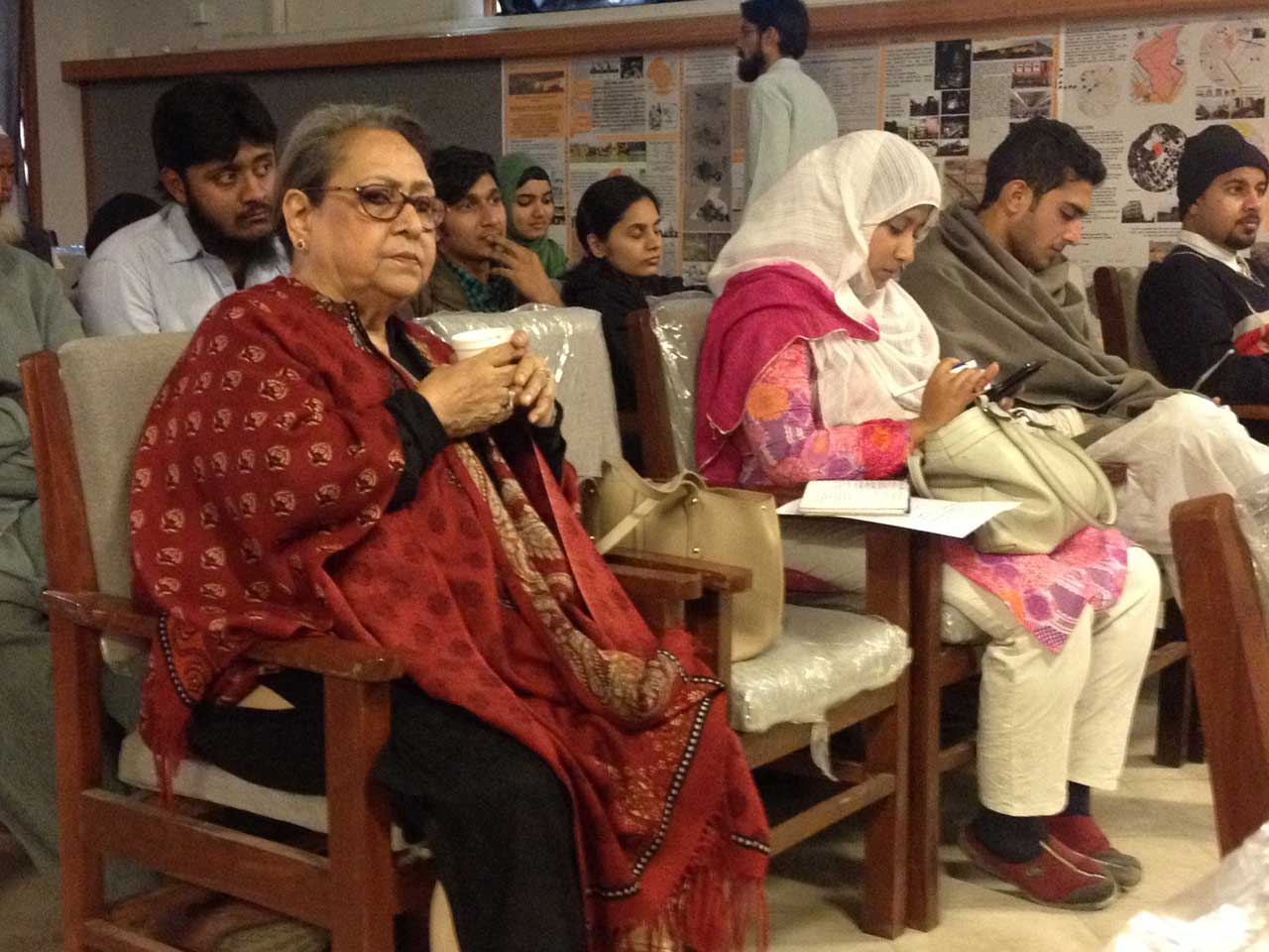 Mrs. Badar Khan is listening the speech by Pervez Said