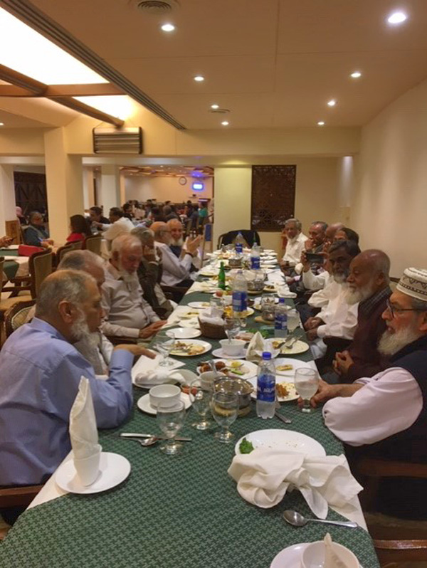 All are enjoying the dinner and chatting with each other