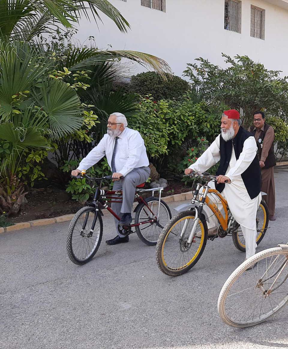 Dr. Saroosh Lodhi, VC NEDUET and Engr. Suhail Bashir, Chairman IEP Karachi Centre are riding the bikes in the Campus