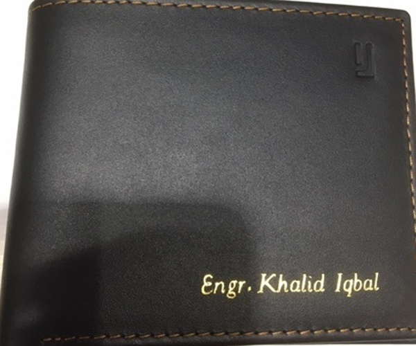 A Leather Wallet with a name on it for Khalid Iqbal
