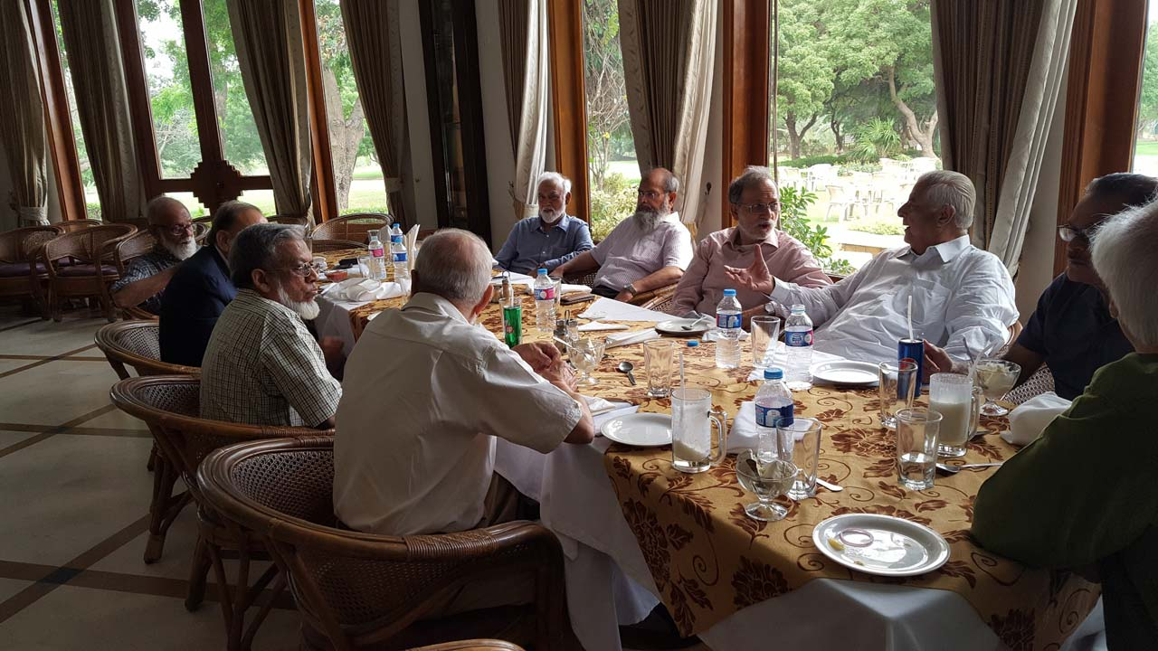 Discussion is ongoing at the dining table