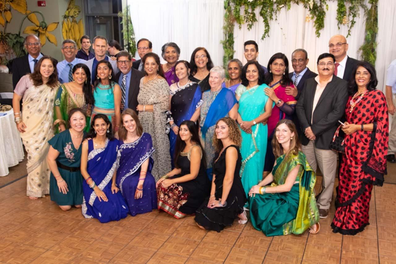 Ex aramcons in attendance were  - Sitting: Mina Choi, Tanaz Khory, Amy Dickens, Simi Khanna, Ruba Ayat, Sarah Davidson  - Standing: Carol Serna, Aneesha Marwah (bride's sister), Natasha Marwah (bride), Ashok Marwah (Father of bride), Kusum Khanna, Neena Marwah (mother of bride), Lynn Love (groom's mother), Unna Ramanathan, Gouri Dharwadkar, Uma Fernandez, Gabriel Fernandez, Shriram Dharwadkar, Raxa Patel,  - Back row: Wilfred Carvalho, Farouk Khory, Jaxon Love (groom), Raj Khanna, Jasmine Carvalho, Yasmin Khory, Steve Khanna, Mukesh Patel