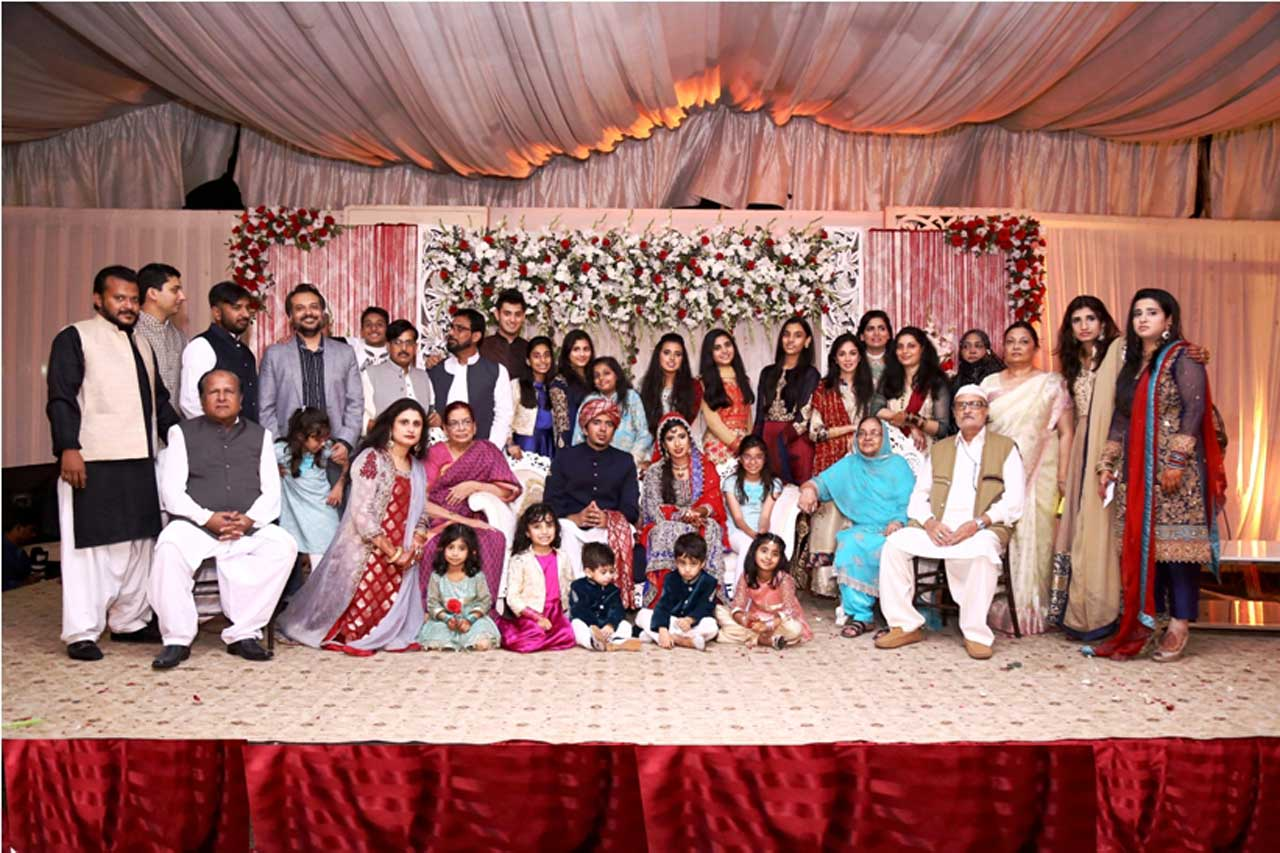 A group photo of the Bride's family at the wedding function