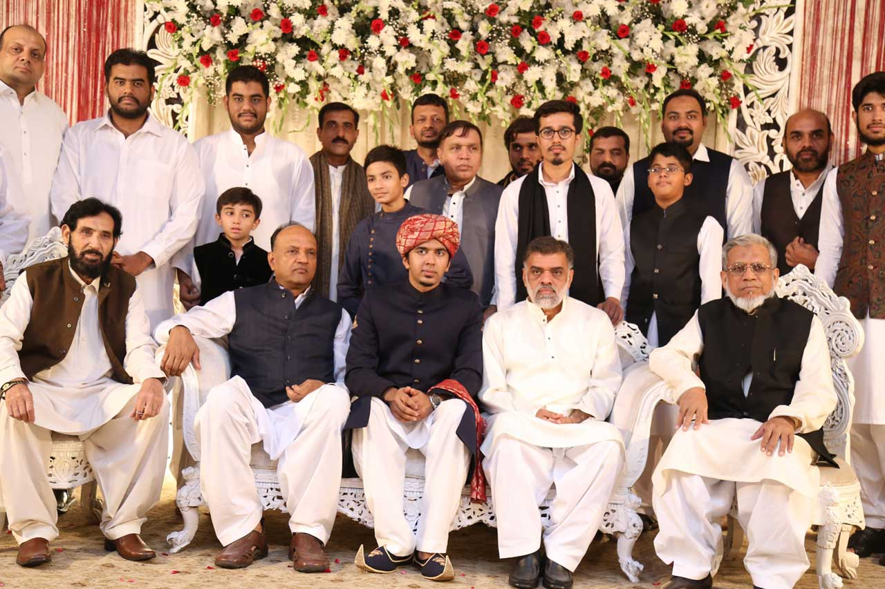 Umair A. Hameed with his father and other relatives