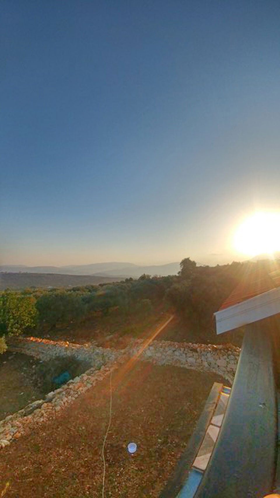 Sunrise from the roof deck at Daily Hugz, Asira al-Shimaliyah, Palestine