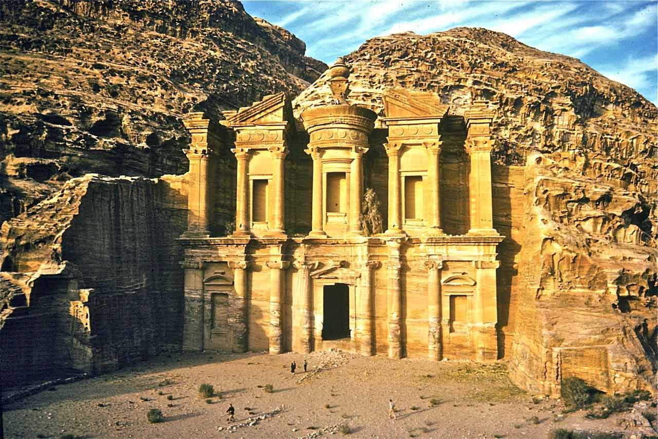 The Ad-Deir. Visitors in this photo at the doorway and at the top lend perspective to the size of this massive structure.